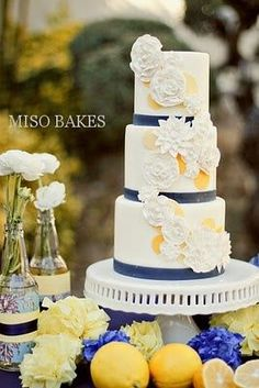 Art Navy blue, white and yellow couture wedding cake... would work well with a nautical theme.