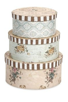 "Ella Elaine Hat Boxes - Set of 3 by Imax A delightful statement that is great for extra storage, these hat boxes are perfect for any shelf.  - Cardboard construction - Set of 3 - Imported  Set includes:  - Small: 3.5"" H x 7.5"" D - Medium: 4"" H x 8.625"" D - Large: 4.5"" H x 10"" D  Orders cannot be shipped to Canada, Alaska, Hawaii, Puerto Rico or P.O. Boxes. Materials Cardboard $63.00"