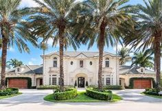 Extraordinary residence in the prestigious Royal Palm Yacht & Country Club. Set on a double lot with golf course views to the south, east and west, this 8,662-total-square-foot English Manor has six bedrooms, seven bathrooms, a half-bath, wine room, grand staircase, and a four-and-a-half-car garage. Featuring a grand architectural style, its owners will enjoy the serenity of its beautifully landscaped English gardens, pool and fountain.