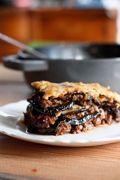 An authentic, delicious recipe for Rustic Eggplant Moussaka- perfect for entertaining or serving at a  special gathering. Can be made ahead and baked prior to serving. #moussaka #eggplant #eggplantmoussaka #lamb #vegetarianmoussaka