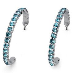 "Stunning Swarovski Earrings made of rhodium plated metal. These earring hang 1.52"" long and are 1.5"" wide. 25 Sparkling Indicolite Blue Swarovski Crystals give these earrings their charm."