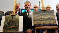 Director of the Van Gogh museum Axel Ruger (C)  poses with two Van Gogh paintings recovered in Italy 14 years after they were stolen in Amsterdam