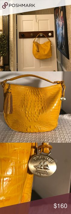 """Brahmin croc embossed leather bag Beautiful Brahmin hobo slouch style in a yellow with orange accents color. Has hangtag with plastic covering on it to keep brass pristine. Tassels zipper pull. Zipper closure. 14 x 4"""" x 12"""" x 9"""" strap drop.croc leather. Suede / or velvet interior EUC. mint exterior condition. GORGEOUS. Make me an offer!!! Brahmin Bags"""