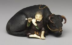 Netsuke: Ox with boy playing flute [Japanese] Timeline of Art History Boy in Ivory and Ox in wood. Japanese Art, Japanese, Sculptures, Metropolitan Museum Of Art, Netsuke, Sculpture, Art, Japanese Characters, Art History