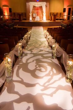 This illuminated aisle gives off such a romantic feel.Photo Credit: Jeff Kolodny Photography