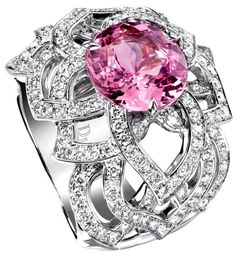 Piaget Rose ring in white gold and brilliant-cut diamonds topped with a pink sapphire. Piaget Rose Day @Piaget
