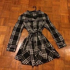 Black and white plaid winter jacket Black and white plaid winter jacket with tie at the waist. Size large and very warm! Jackets & Coats