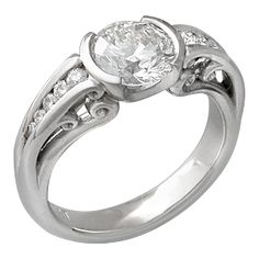 Carved Curls Engagement Ring with Round White Diamond - This award-winning artistic design is magnificently three-dimensional with twelve elegantly shaped curls, six on each side, gracefully surrounding the center stone. Baroque and enchanting, this is truly a miniature sculpture. This version of Carved Curls has ten ideal cut diamonds tapering in the side channels. 3mm wide. - This is an unusual sculptural engagement ring with tapering diamond accents and a semi-bezel set round white…