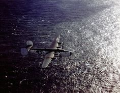 On Sept. 3, 1944, a (PB4Y 1) Liberator plane launches to attack German submarine pens on Helgoland Island. The pilot, Lt. Ralph Spading, sets the radio controls and parachutes out of the Liberator, which is then controlled as a drone by Ensign J.M. Simpson in a (PV 1). Due to weather problems, the drone hits the barracks and industrial area on Dune Island.