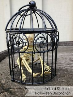 Make a Jailbird Skeleton Halloween Decoration - Dollar Store Crafts