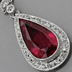 Art Deco Ruby Pendant Antique Style Platinum European-cut Diamonds This Art Deco ruby pendant in antique style platinum with European-cut diamonds weighs exactly 5.0g, measures 23mm long, 12mm wide and 5mm deep and is strung on a delightful platinum necklace chain measuring 16.25 inches long embellished with lustrous seed-pearls.