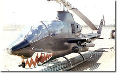 Helicopter #475 with crossed sabers under the nose and Judy in the Sky written on the front seat door. ~ Vietnam War