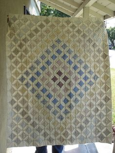 Gray cathedral windows, one of my favorite quilts.