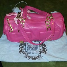 Authentic Juicy Couture purse Authentic pink Juicy Couture purse with pink scarf and gold hardware. Clean interior and exterior. Comes with original dust bag. Juicy Couture Bags
