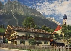 Alpine village against Waxenstein and Zugspitze Mountains, Grainau, Bavaria, Germany | by Striderv