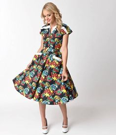 Jump into action with Hedda, dames! Bursting with passion for mid-century comic book pop art, The Hedda Dress from Unique Vintage is an animated piece that will have all the superheroines  applauding. Cast in a classic cotton black, this energetic swing d