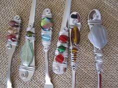 Isn't this cool?  Buy mismatched flatware serving pieces and turn them into one-of-a-kind useful art! :)