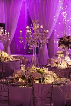 Glamorous wedding ideas | Candelabra and purple uplighting