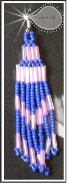 Aretes largos elaborados con canutillos y chaquiras by Tupi'na Bijoux.
