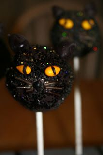 Black Cat Cake Pops) I don't like cakepops, at all, but these look so fun.