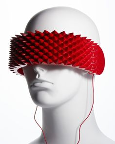 OneSense headphones cover the eyes, and are covered with red spikes on the outside, to alert others not to intrude.
