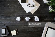 Stock Photo : Blank sheets of paper, pencil, smartphone and crumbled papers on black wood