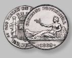 """1 peseta del Gobierno Provisional 1870 The first coin minted in 1869 was the unit. It came into being bearing the legend """"Gobierno Provisional"""" on the obverse, instead of """"Spain"""" The motif chosen was the personification of Hispania resting on the Pyrennees inspired by the coins of the Emperor Hadrian. The bronze coin,  represented Spain as a matronly figure sitting on the rocks. Both were engraved by Luis Marchionni, who, from 1861 held the position of principal engraver the Royal Madrid…"""