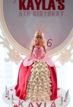 Cute barbie princess cake! Pink Princess themed birthday party with Such Darling Ideas via Kara's Party Ideas! Full of decorating ideas, favors, games, cakes, printables, and MORE! KarasPartyIdeas.com #princessparty #pinkprincess #partyideas #partydecor #partystyling #eventplanning #partydesign (6)