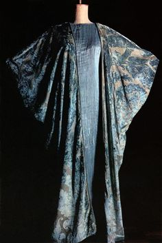 Fortuny silk velvet cloak over a blue and grey silk satin Delphos. the 'Delphos robe' … is undoubtedly Fortuny's mo...