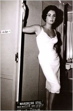 Liz Taylor in old fashioned dress slip                                                                                                                                                                                 More