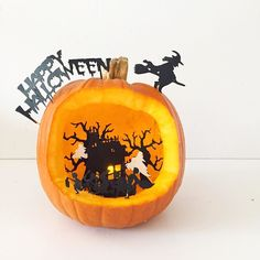 Find out how to make this DIY Diorama Pumpkin on theseglitteryhands.com now! It's spookily simple! #pumpkin #pumpkincarving #pumpkinideas #diorama #cblogger #halloween #halloweendiy #spooky #happyhalloween #trickortreat #cricutexplore #cricutexploreair #cricutcrafts #craftlife #imadethis #molliemakers #witch #hauntedhouse
