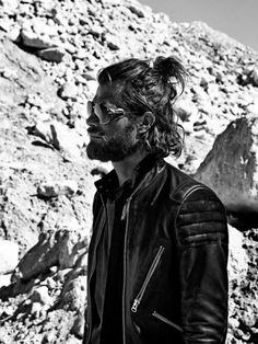 MAN BUN.  And sunglasses, beard, and leather jacket.  Very cool black and white photo.