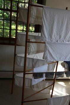A wooden folding drying rack.