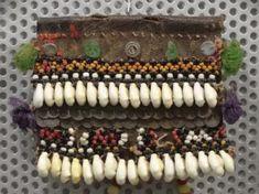 """Украшение женское марийское нагрудное """"Шушер""""  Период создания:рубеж XIX - ХХ вв. Материал, техника:раковины каури, кожа натуральная, ткань шерстяная, нить шерстяная, бисер, металл, ручная работа Размер:11 х 15 см Браслеты, Ювелирные Украшения"""