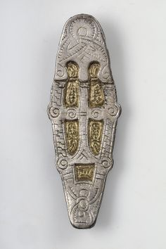 Object from the exhibition We call them Vikings produced by The Swedish History Museum Pendant Bronze and white metal   Stora Åby, Bro, Gotland, Sweden. SHM 6069