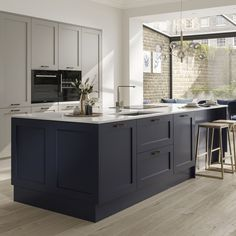 Create a striking two-tone scheme using a pebble kitchen and navy kitchen. A classic design with a modern twist. An authentic timber style with real woodgrain. Pair with white worktops and pale wooden floors for a contemporary feel. Two Tone Kitchen Cabinets, Contemporary Kitchen Cabinets, Contemporary Kitchen Design, Interior Design Kitchen, White Kitchen Worktop, Timber Kitchen, Wooden Kitchen, Contemporary Style, Kitchen Appliances
