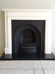 Excellent Photos white Fireplace Hearth Popular Installation of a Crown cast iron insert with a Limestone mantel and granite hearth. Fake Fireplace, Fireplace Hearth Stone, Living Room With Fireplace, Cast Iron Fireplace, Fireplace Hearth, Contemporary Fireplace, Victorian Fireplace
