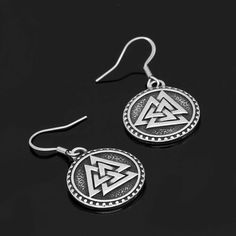 "The Valknut (coined from Old Norse valr, ""slain warriors"" and knut, ""knot"") is a symbol consisting of three interlocked triangles. It symbolizes the power of Odin to bind and unbind the mind, relieving his chosen warriors from tension and fear while binding his enemies so they become helpless in battle.