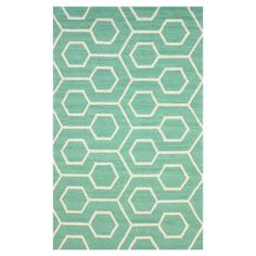 Anchor your sunroom or patio seating arrangement in chic style with this elegant rug, showcasing a geometric motif in seafoam.       Produ...