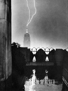 View from the RCA Building of lightning striking the top of the Empire State Building, June 1944.