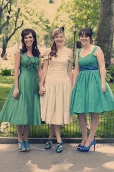 Prolly not for this wedding, but they're pretty cute :) 1950s Peacock-Inspired Wedding and green bridesmaid dresses.