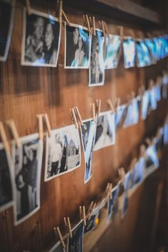 Creative way to hang pictures that works perfectly with the barn wedding theme