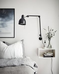 Instead of putting a lamp on a surface where it takes up useful #space hang it on the wall and use that space for something else.  #BedroomSpaceSavers #themeoftheweek #ESTipOfTheDay #EsHappyList