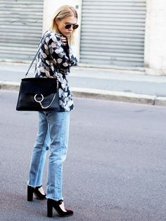 Courtney Trop wears a printed silk jacket with vintage jeans, velvet Mary Jan heels, and a Chloé shoulder bag