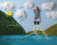 Cute photo of an adorable newborn baby boy fly boarding at the lake. Funny unique amazing creative baby scene summer water sports bathing suit swimming trunks Baby ImaginArt by Angela Forker Precious Baby Photography Fort Wayne New Haven Indiana