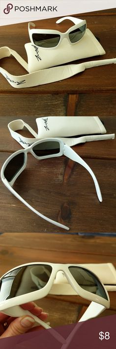 Baby BanZ Sunglasses  White.. Barely worn! Not sure these were ever worn. No scratches on lenses. Comes with matching head strap and case. The case is a little dirty but can probably be washed.   Sized for younger children....around age 4.  From Amazon..Top Quality for Uncompromised Safety: We, at BanZ take your children's safety seriously. All of our products are 100% kid-friendly and free from dangerous chemicals. Fully CPSIA and Cali. Prop. 65 Compliant and doctor recommended, our kids…