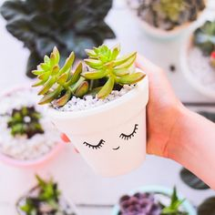 Jess Viera created an easy (and beyond sassy) vase for succulents. Your bridesmaids will love receiving this decorative gift. All you need to do is cover the clay pot in white matte paint, let it dry, and add whatever details and fill with succulents. We absolutely adore the face she made here, but you can customize it for each girl with fun patterns and designs.