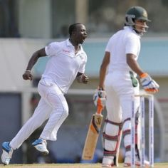 Kemar Roach put on a fiery display of pace bowling to reduce Bangladesh