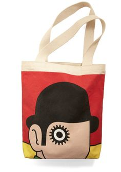 """Combine the two when you toss your next best-seller within the inner pocket of this Out of Print tote, designed with an old cover of """"A Clockwork Orange."""" For every one of these adorable canvas totes sold, a book is donated to a community in need, so claim yours today, and proudly hang it over the shoulder"""