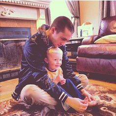 TYLER PLAYING WITH JENNA'S NEPHEW'S LITTLE TOES THEY BOTH LOOK SO HAPPY. DO YOY SEE THE LOOK OM TYLER'S FACE. HE LOOKS SO CONTENT AND CARING WITH THIS LIL BABY TUCKED IN HIS LAP I'M DEAD PLEASE HELP.